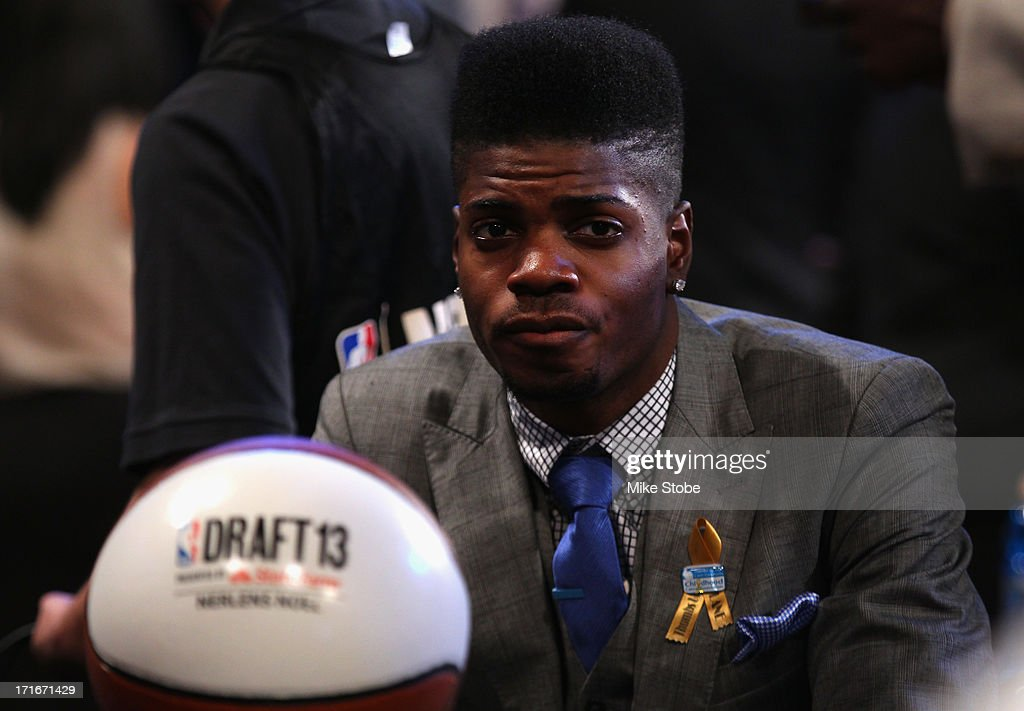 <a gi-track='captionPersonalityLinkClicked' href=/galleries/search?phrase=Nerlens+Noel&family=editorial&specificpeople=7880842 ng-click='$event.stopPropagation()'>Nerlens Noel</a> of Kentucky looks on as he sits in the draft green room during the first round of the 2013 NBA Draft at Barclays Center on June 27, 2013 in in the Brooklyn Borough of New York City.