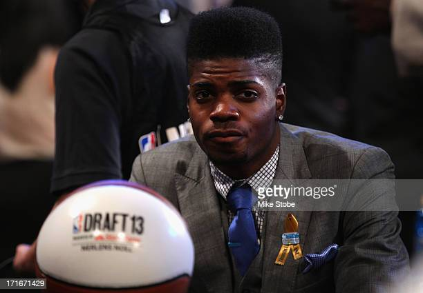Nerlens Noel of Kentucky looks on as he sits in the draft green room during the first round of the 2013 NBA Draft at Barclays Center on June 27 2013...