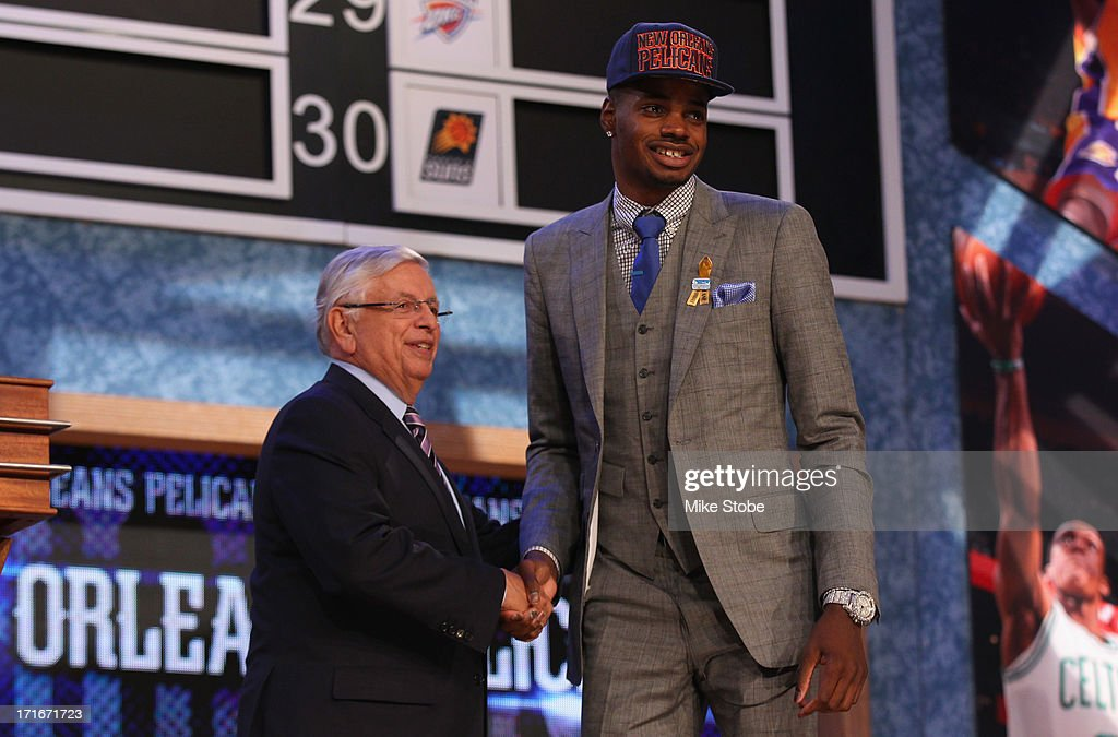<a gi-track='captionPersonalityLinkClicked' href=/galleries/search?phrase=Nerlens+Noel&family=editorial&specificpeople=7880842 ng-click='$event.stopPropagation()'>Nerlens Noel</a> (R) of Kentucky poses for a photo with NBA Commissioner <a gi-track='captionPersonalityLinkClicked' href=/galleries/search?phrase=David+Stern&family=editorial&specificpeople=206848 ng-click='$event.stopPropagation()'>David Stern</a> after Zeller was drafted #6 overall in the first round by the New Orleans Pelicans during the 2013 NBA Draft at Barclays Center on June 27, 2013 in in the Brooklyn Bourough of New York City.