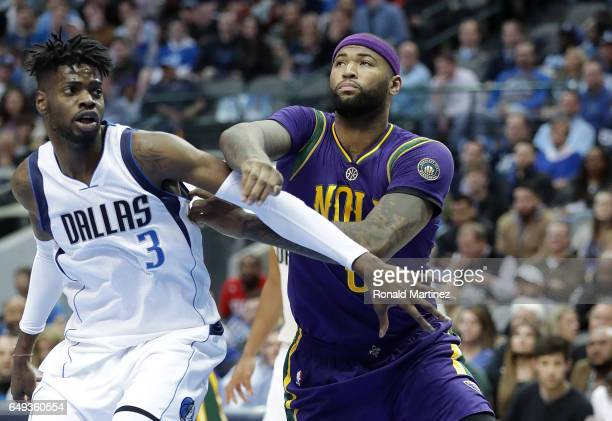 Nerlens Noel of the Dallas Mavericks and DeMarcus Cousins of the New Orleans Pelicans during the first half at American Airlines Center on February...