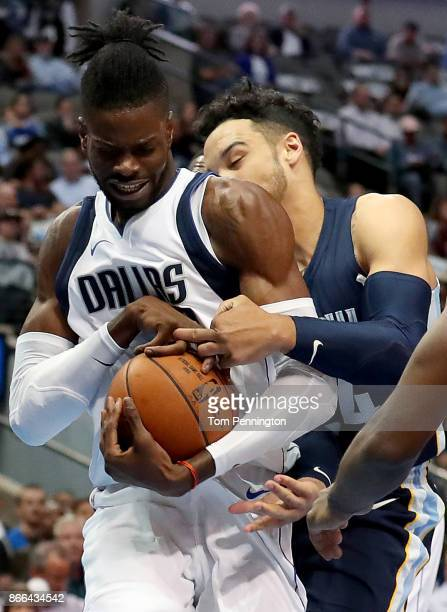 Nerlens Noel of the Dallas Mavericks scrambles for control of the ball against Dillon Brooks of the Memphis Grizzlies in the first half at American...