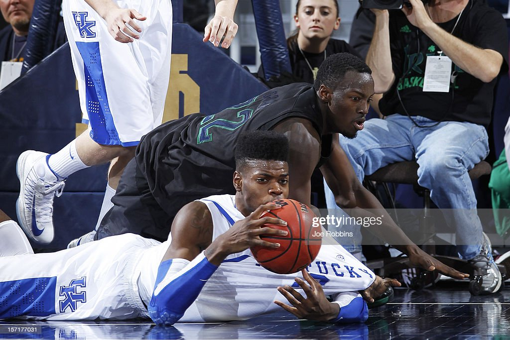 <a gi-track='captionPersonalityLinkClicked' href=/galleries/search?phrase=Nerlens+Noel&family=editorial&specificpeople=7880842 ng-click='$event.stopPropagation()'>Nerlens Noel</a> #3 of the Kentucky Wildcats battles for a loose ball against Jerian Grant #22 of the Notre Dame Fighting Irish during the game at Purcell Pavilion at the Joyce Center on November 29, 2012 in South Bend, Indiana. Notre Dame won 64-50.