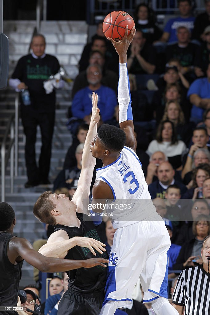<a gi-track='captionPersonalityLinkClicked' href=/galleries/search?phrase=Nerlens+Noel&family=editorial&specificpeople=7880842 ng-click='$event.stopPropagation()'>Nerlens Noel</a> #3 of the Kentucky Wildcats shoot the ball against Jack Cooley #45 of the Notre Dame Fighting Irish during the game at Purcell Pavilion at the Joyce Center on November 29, 2012 in South Bend, Indiana. Notre Dame won 64-50.