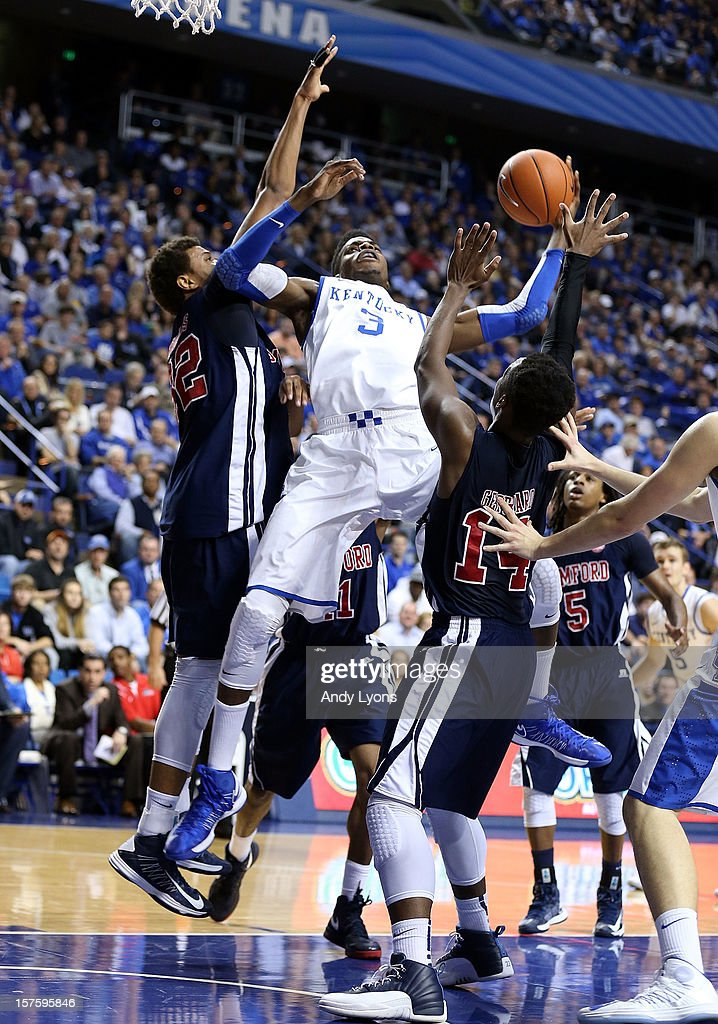 <a gi-track='captionPersonalityLinkClicked' href=/galleries/search?phrase=Nerlens+Noel&family=editorial&specificpeople=7880842 ng-click='$event.stopPropagation()'>Nerlens Noel</a> #3 of the Kentucky Wildcats shoots the ball while defended by Tim Williams #32 and Clide Geffrard#14 of the Samford Bulldogsduring the game at Rupp Arena on December 4, 2012 in Lexington, Kentucky.