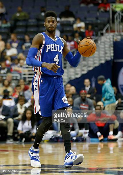 Nerlens Noel of the Philadelphia 76ers brings the ball up the floor during the first half against the Washington Wizards at Verizon Center on October...