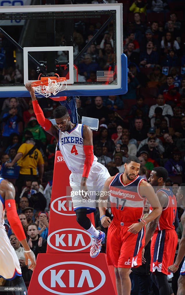 Nerlens Noel #4 of the Philadelphia 76ers catches a rebound and dunks the ball against the Washington Wizards at Wells Fargo Center on February 27, 2015 in Philadelphia, Pennsylvania