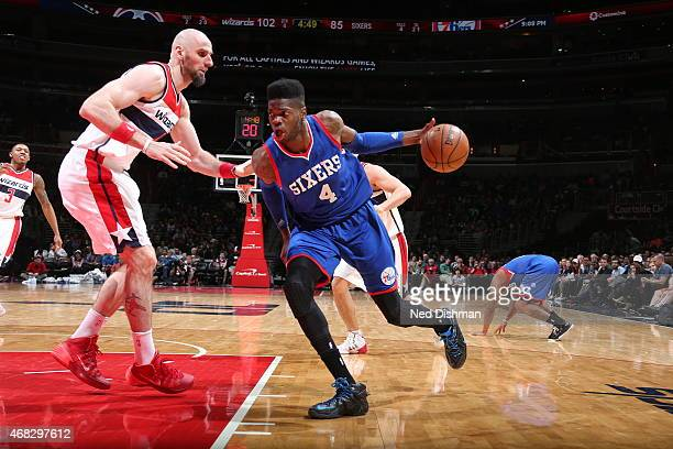 Nerlens Noel of the Philadelphia 76ers drives to the basket against Marcin Gortat of the Washington Wizards on April 1 2015 at the Verizon Center in...
