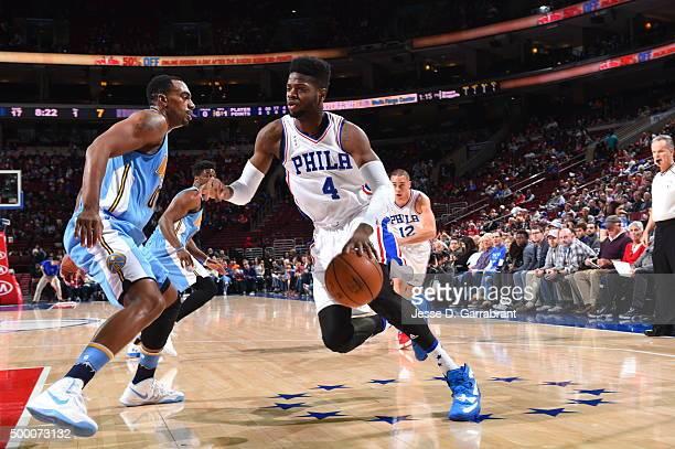 Nerlens Noel of the Philadelphia 76ers drives to the basket against the Denver Nuggets at Wells Fargo Center on December 5 2015 in Philadelphia...