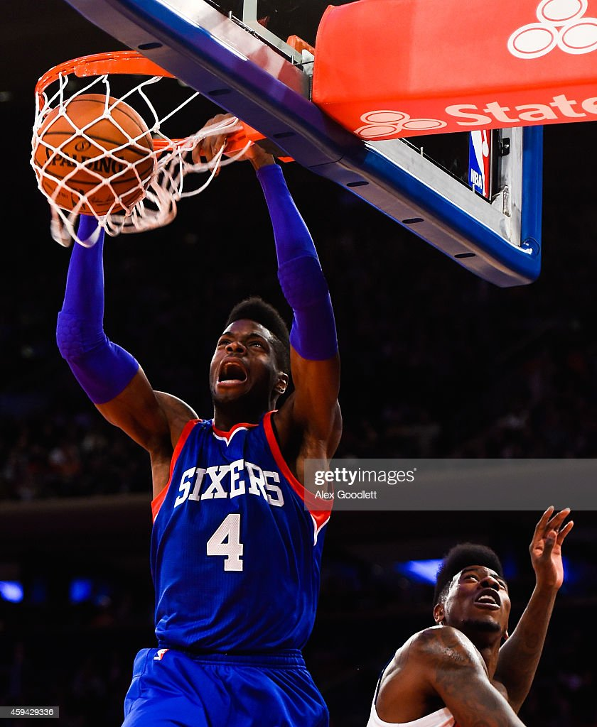 Nerlens Noel #4 of the Philadelphia 76ers dunks over Iman Shumpert #21 of the New York Knicks in the first quarter at Madison Square Garden on November 22, 2014 in New York City.