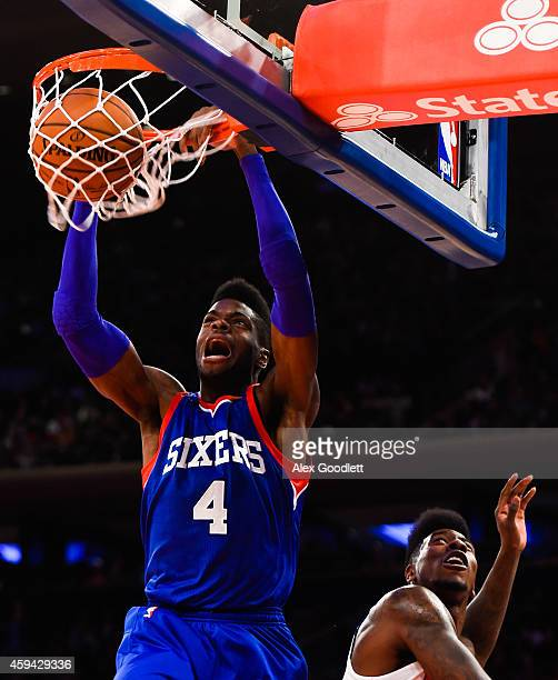 Nerlens Noel of the Philadelphia 76ers dunks over Iman Shumpert of the New York Knicks in the first quarter at Madison Square Garden on November 22...