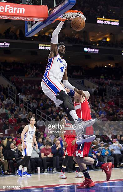 Nerlens Noel of the Philadelphia 76ers dunks the ball against Marcin Gortat of the Washington Wizards on February 26 2016 at the Wells Fargo Center...