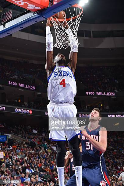 Nerlens Noel of the Philadelphia 76ers dunks the ball against the Atlanta Hawks at Wells Fargo Center on March 7 2015 in Philadelphia Pennsylvania...