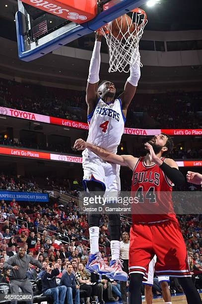 Nerlens Noel of the Philadelphia 76ers dunks the ball against the Chicago Bulls at Wells Fargo Center on March 11 2015 in Philadelphia Pennsylvania...