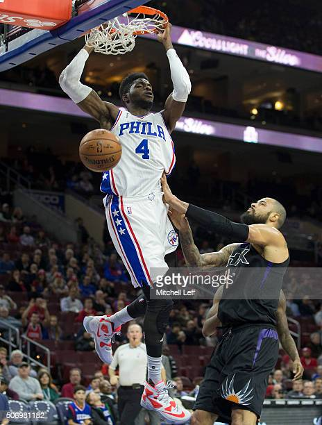 Nerlens Noel of the Philadelphia 76ers dunks the ball past Tyson Chandler of the Phoenix Suns on January 26 2016 at the Wells Fargo Center in...