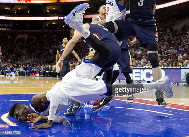 Nerlens Noel of the Philadelphia 76ers falls on the court trying to block a shot in the game against the New Orleans Pelicans on January 16 2015 at...