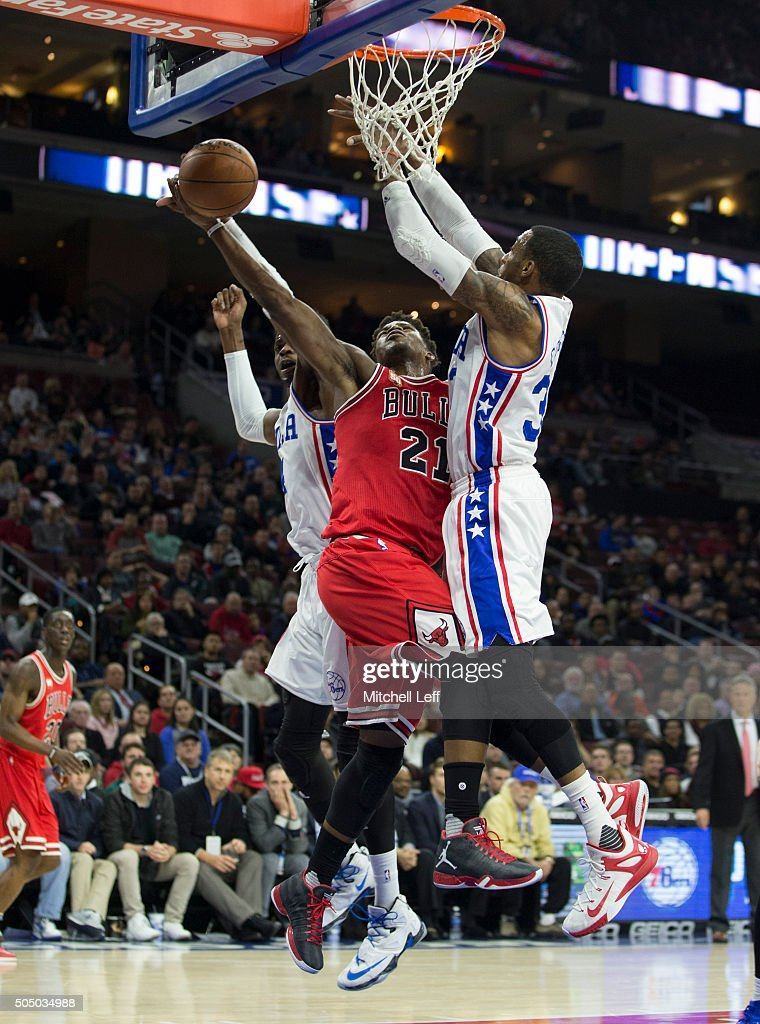 Nerlens Noel #4 of the Philadelphia 76ers fouls Jimmy Butler #21 of the Chicago Bulls on January 14, 2016 at the Wells Fargo Center in Philadelphia, Pennsylvania.