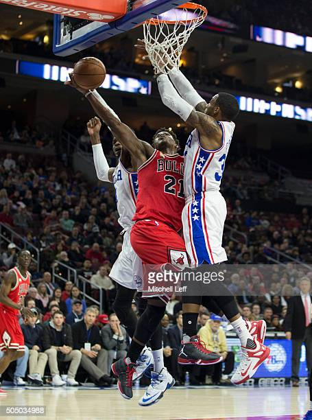 Nerlens Noel of the Philadelphia 76ers fouls Jimmy Butler of the Chicago Bulls on January 14 2016 at the Wells Fargo Center in Philadelphia...