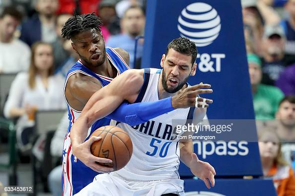 Nerlens Noel of the Philadelphia 76ers fouls Salah Mejri of the Dallas Mavericks in the first half at American Airlines Center on February 1 2017 in...