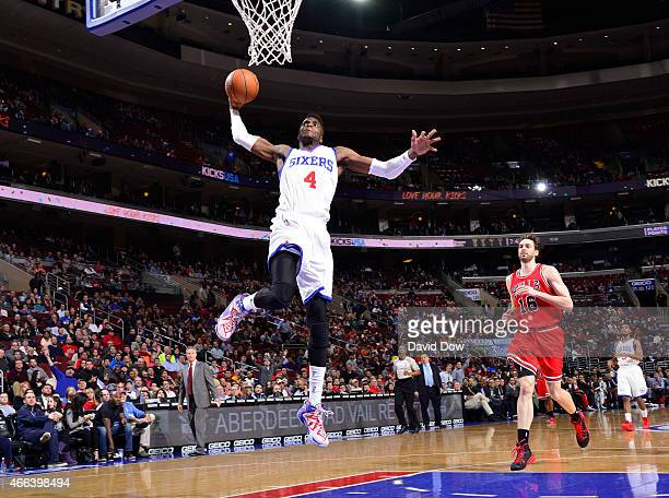 Nerlens Noel of the Philadelphia 76ers goes up for the dunk against the Chicago Bulls at the Wells Fargo Center on March 11 2015 in Philadelphia...