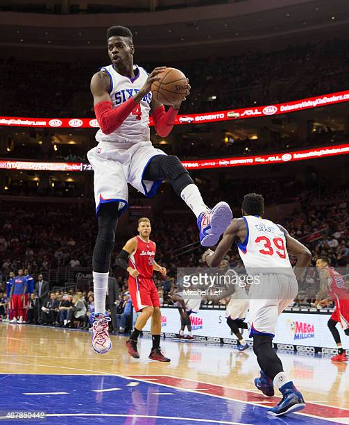 Nerlens Noel of the Philadelphia 76ers grabs a rebound against the Los Angeles Clippers on March 27 2015 at the Wells Fargo Center in Philadelphia...