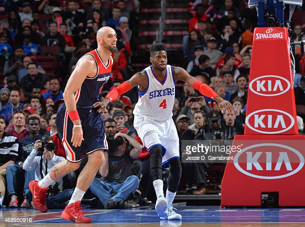 Nerlens Noel of the Philadelphia 76ers waits for the ball against Marcin Gortat of the Washington Wizards at Wells Fargo Center on April 8 2015 in...