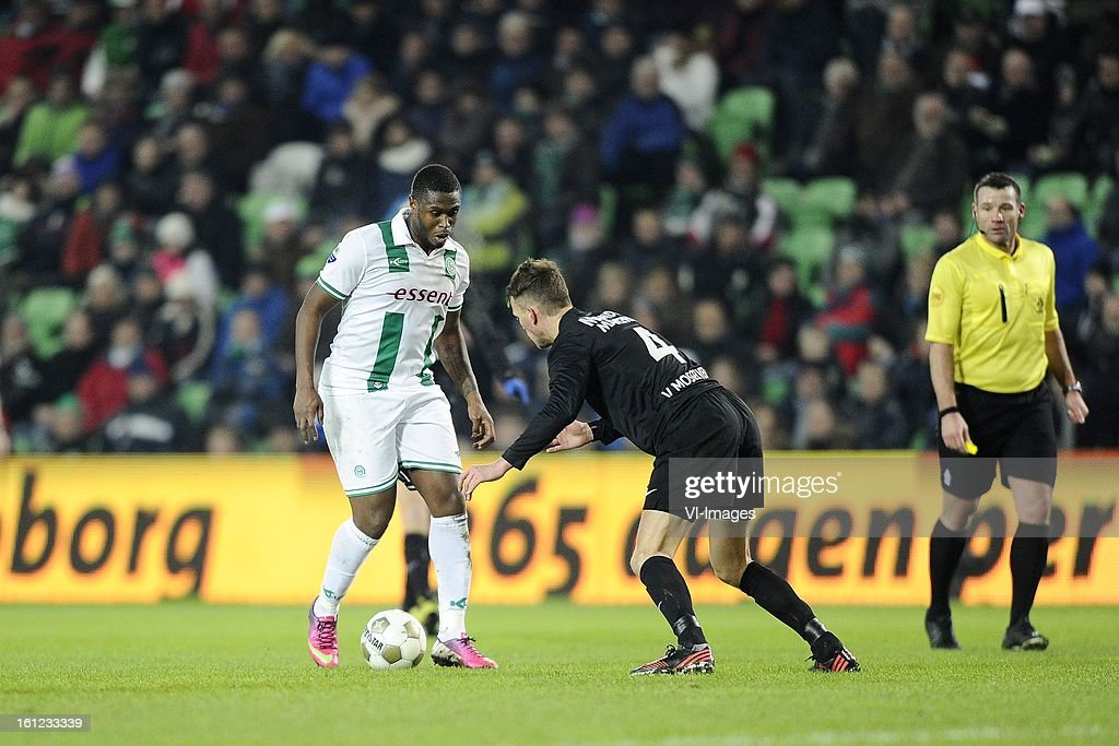 Género Zeefuik of FC Groningen, Frank van Mosselveld of RKC Waalwijk, Referee Pieter Vink, during the Dutch Eredivisie match between FC Groningen and RKC Waalwijk at the Euroborg on february 9, 2013 in Groningen, The Netherlands
