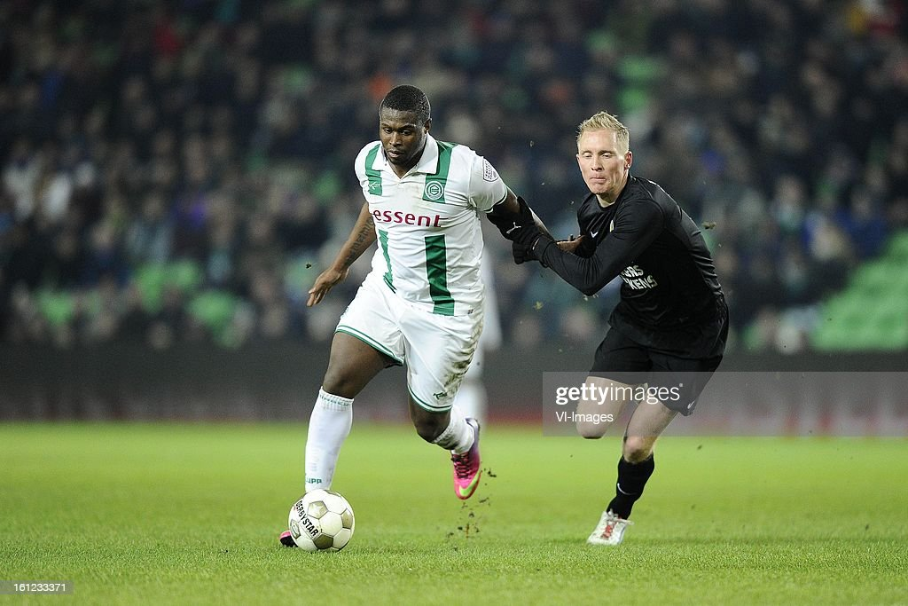 Género Zeefuik of FC Groningen, Henrico Drost of RKC Waalwijk, during the Dutch Eredivisie match between FC Groningen and RKC Waalwijk at the Euroborg on february 9, 2013 in Groningen, The Netherlands