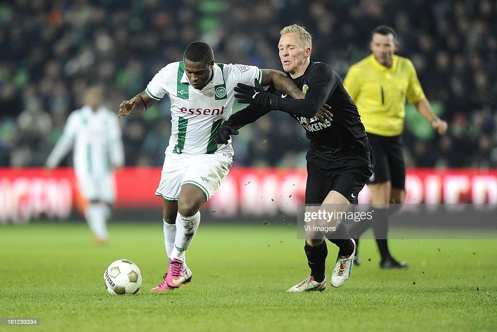 Género Zeefuik of FC Groningen, Henrico Drost of RKC Waalwijk, Referee Pieter Vink, during the Dutch Eredivisie match between FC Groningen and RKC Waalwijk at the Euroborg on february 9, 2013 in Groningen, The Netherlands