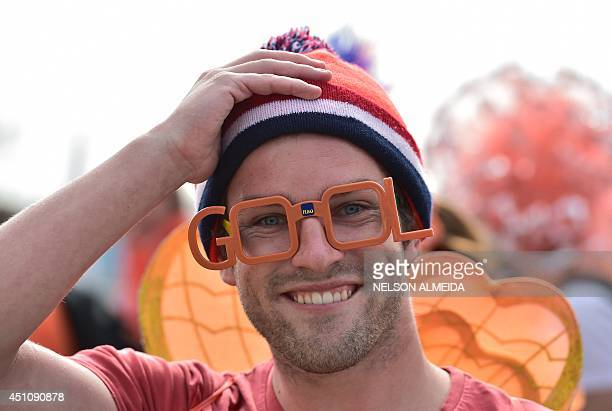 A Nertherlands' fan arrives for the Group B football match between Netherlands and Chile at the Corinthians Arena in Sao Paulo during the 2014 FIFA...
