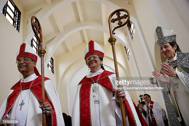 Nerva Cot and Ulises Aguero are recognized after being consecrated as bishops by the Episcopal Church at the Episcopal Cathedral June 10 2007 in...