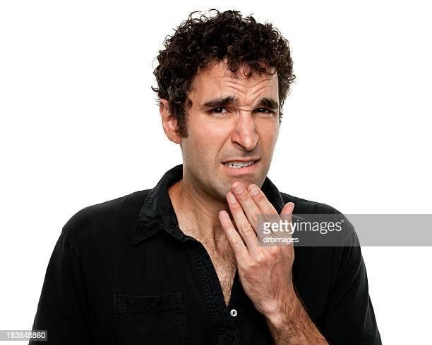Nervös unsicher junger Mann Grimassieren
