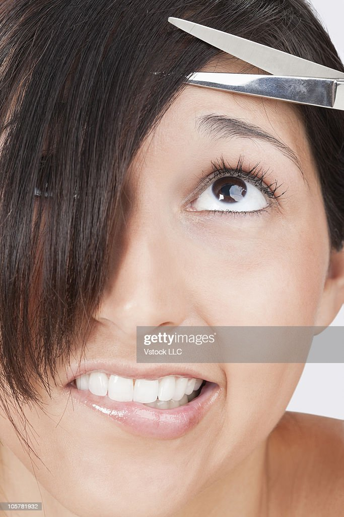 Nervous woman getting a haircut
