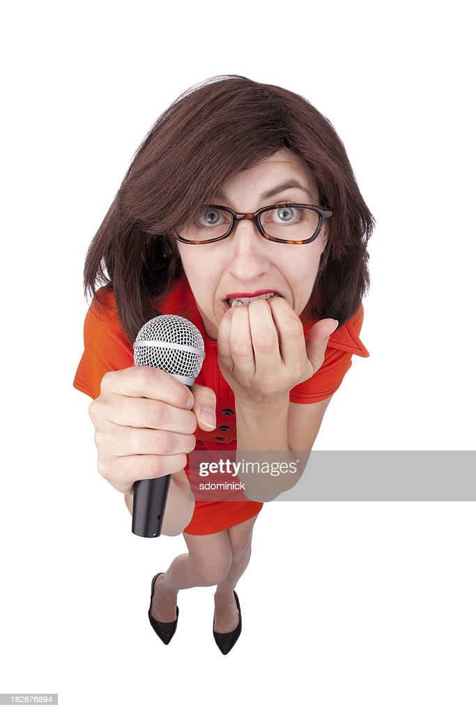 Nervous Woman Holding Microphone : Stock Photo