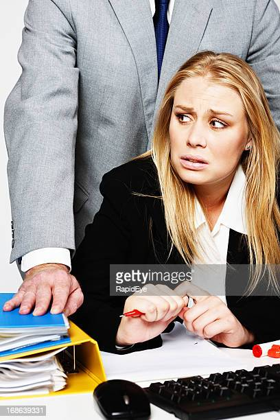 Nervous young businesswoman is hassled by too-close man