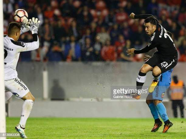 Nery Andres Dominguez of Independiente kicks the ball to score the fourth goal of his team during the first leg match between Independiente and...