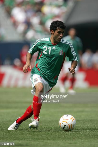 Nery Castillo of Mexico moves the ball against the USA during the CONCACAF Gold Cup Final match at Soldier Field on June 24 2007 in Chicago Illinois...