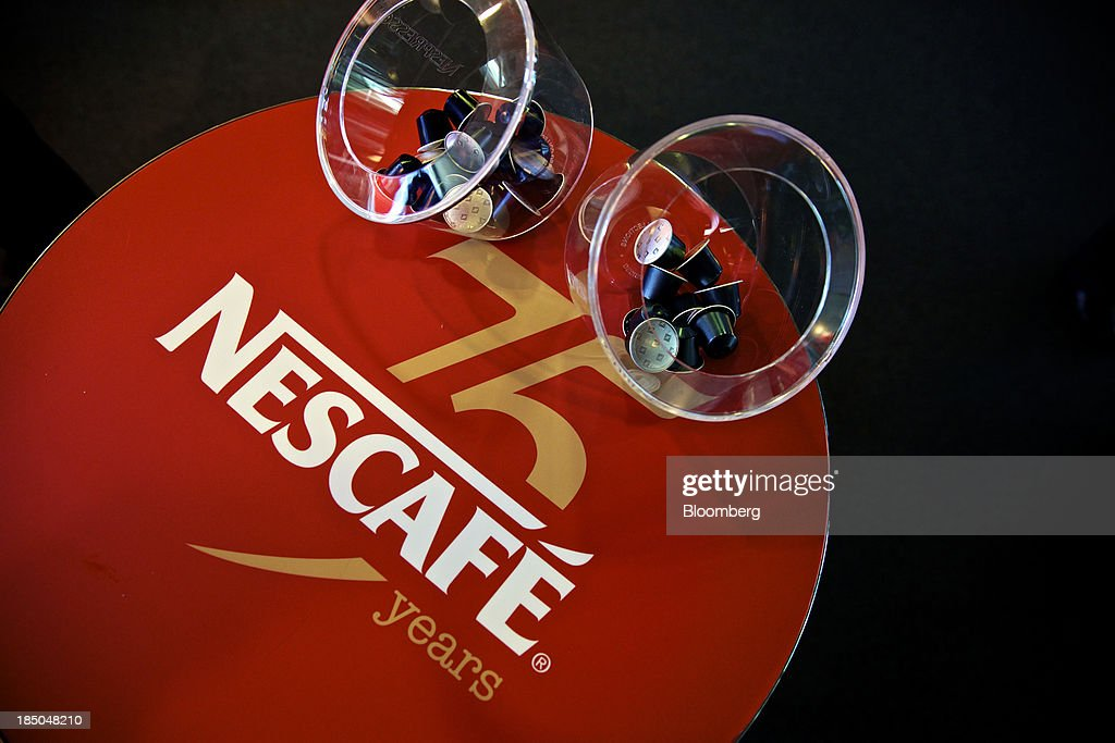 A Nescafe coffee logo sits on a table inside the headquarters of Nestle SA in Vevey, Switzerland, on Thursday, Oct. 17, 2013. Nestle SA, the world's biggest food company, reported nine-month sales that were below its full-year target rate, highlighting the difficult environment faced by the makers of consumer products. Photographer: Gianluca Colla/Bloomberg via Getty Images