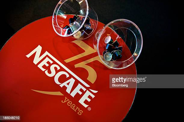 A Nescafe coffee logo sits on a table inside the headquarters of Nestle SA in Vevey Switzerland on Thursday Oct 17 2013 Nestle SA the world's biggest...
