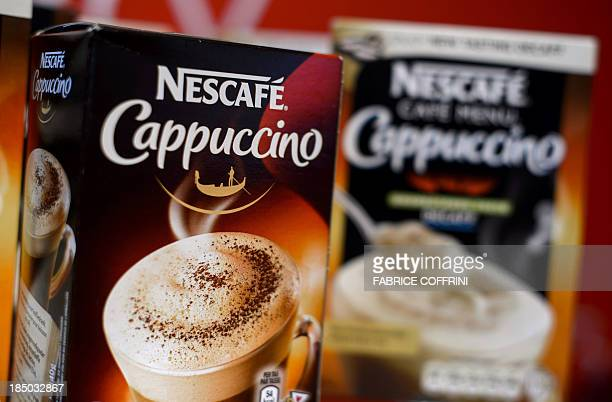 Nescafe coffee products are displayed at the headquarters of the world's biggest food company Nestle on October 17 2013 in Vevey The turnover of the...