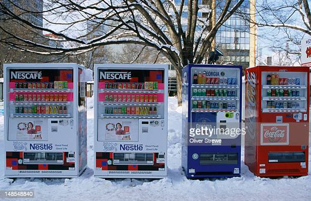 Nescafe, Georgia and Coca-cola vending machines on a street in mid-winter