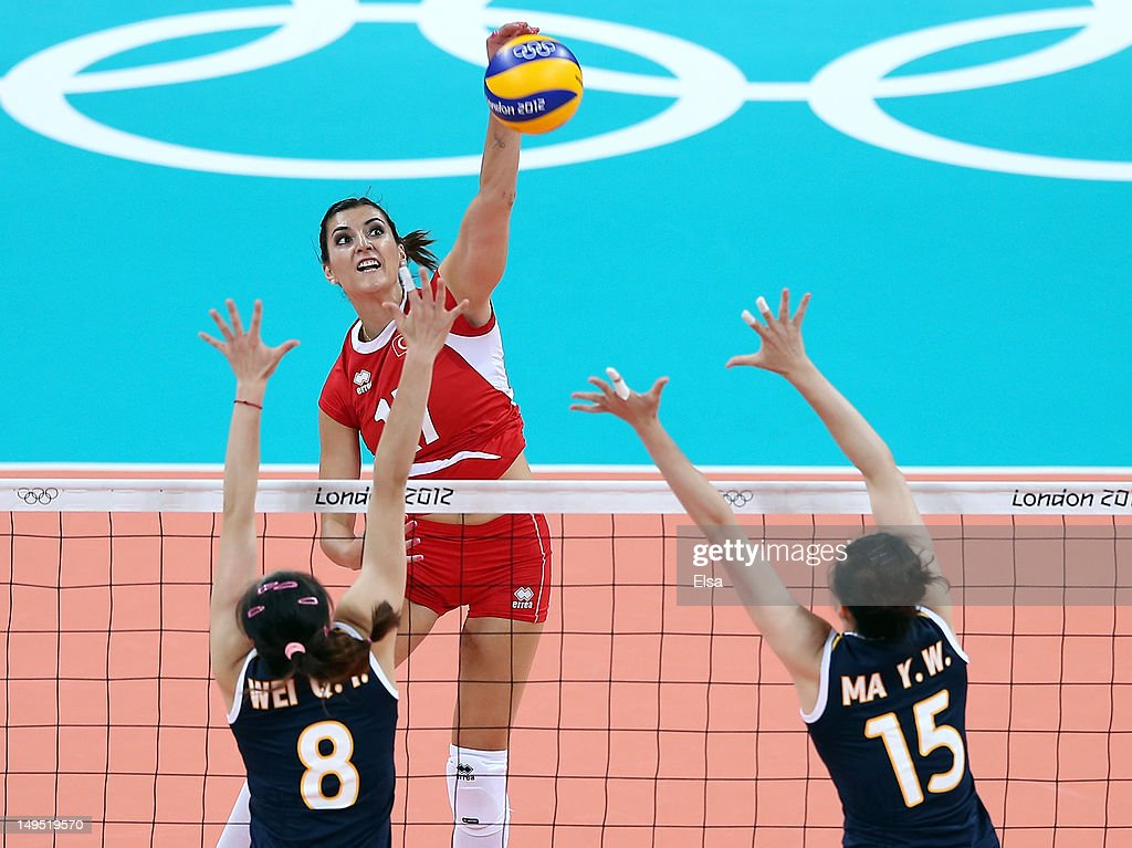 Neslihan Darnel #17 of Turkey spikes the ball as Qiuyue Wei and <a gi-track='captionPersonalityLinkClicked' href=/galleries/search?phrase=Yunwen+Ma&family=editorial&specificpeople=5485134 ng-click='$event.stopPropagation()'>Yunwen Ma</a> #15 of China defend during Women's Volleyball on Day 3 of the London 2012 Olympic Games at Earls Court on July 30, 2012 in London, England.