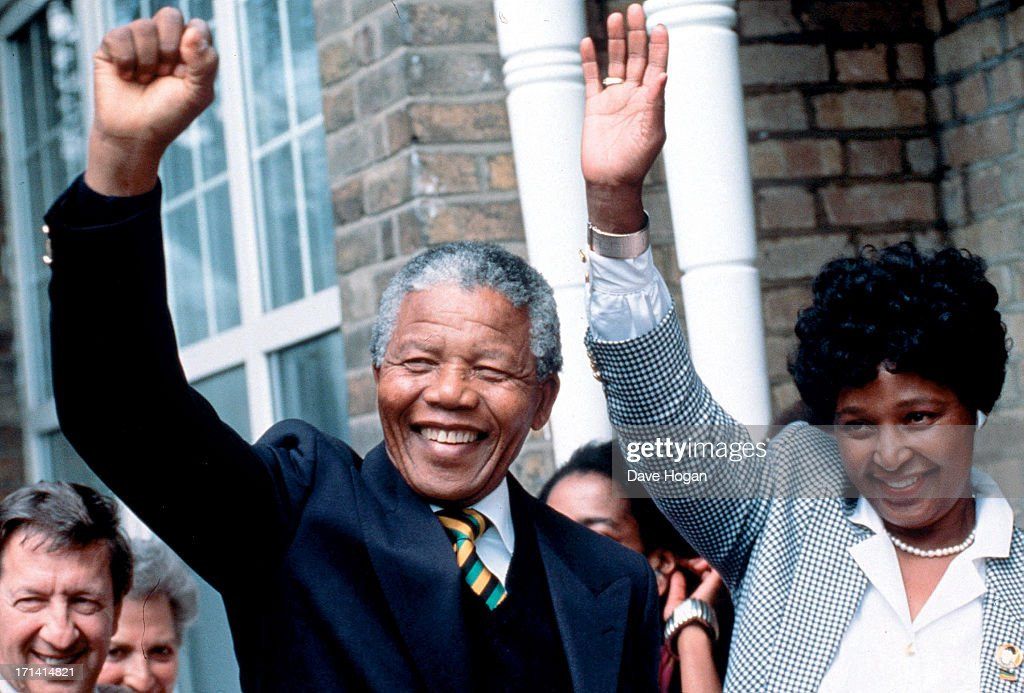 Neslon Mandela and wife Winnie Mandela wave as they visit the Muswell Hill home of the ANC leader Oliver Tambo before heading on to Wembley for the...