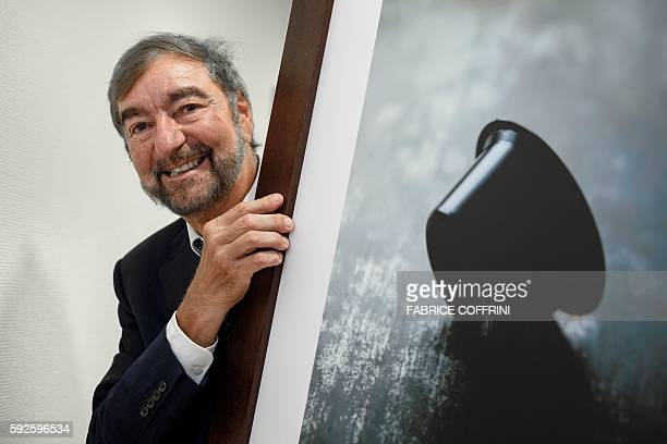 Nespresso inventor Eric Favre poses with a picture of a capsule on July 27 2016 in SaintBarthelemy western Switzerland Had Eric Favre not married an...