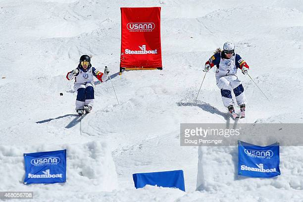 Nessa Dziemian skis to victory against second place finisher K C Oakley in the ladies' final of dual moguls at the 2015 US Freestyle Ski National...