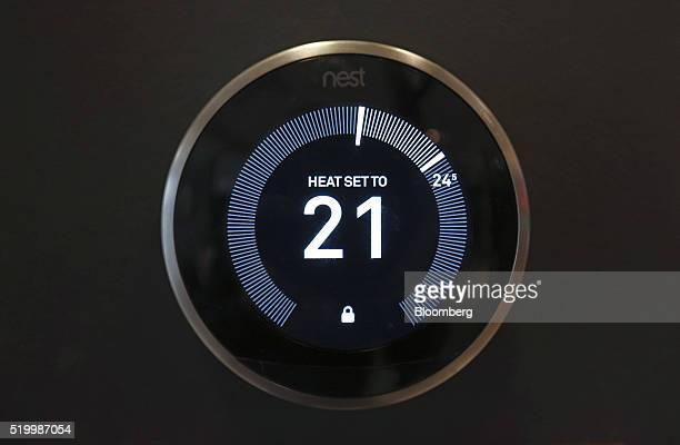 A Nest Labs Inc digital wireless controlled thermostat sits on display in the Smart Home section of a John Lewis Plc department store in London UK on...