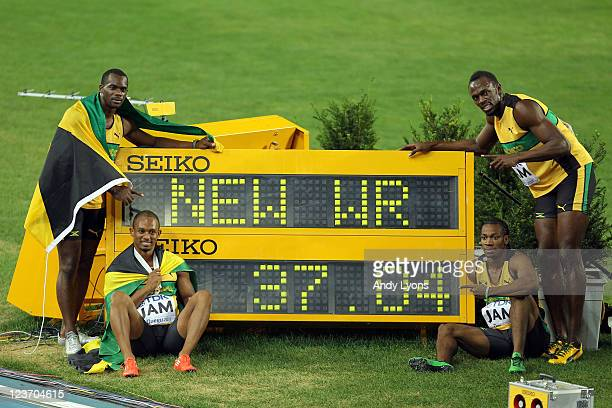 Nesta Carter Michael Frater Yohan Blake and Usain Bolt of Jamaica celebrate victory and a new world record in the men's 4x100 metres relay final...
