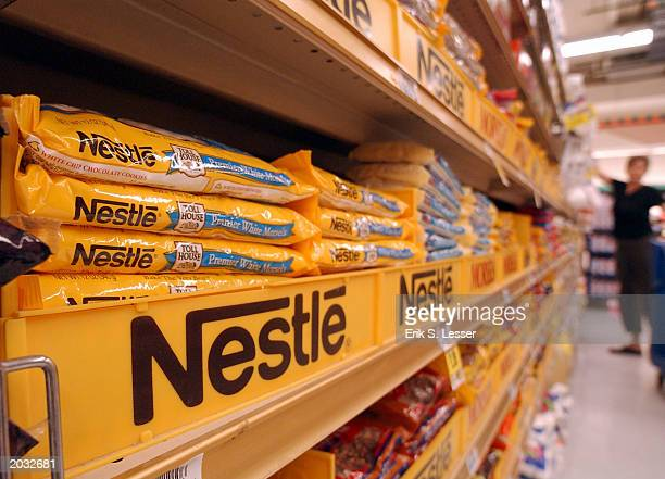 Nestle chocolate products are displayed on the shelves of a Kroger supermarket May 27 2003 in Decatur Georgia Nestle Chief Executive Peter Brabeck...