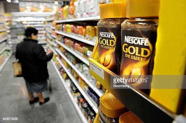 Nestle'S Nescafe on display in a supermarket in Biel Switzerland on Monday Nov 17 2008 Nestle SA the maker of Perrier bottled water and Nesquik...