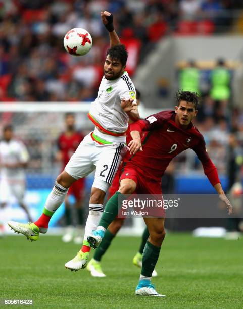 Nestor Araujo of Mexico and Andre Silva of Portugal battle to win a header during the FIFA Confederations Cup Russia 2017 PlayOff for Third Place...