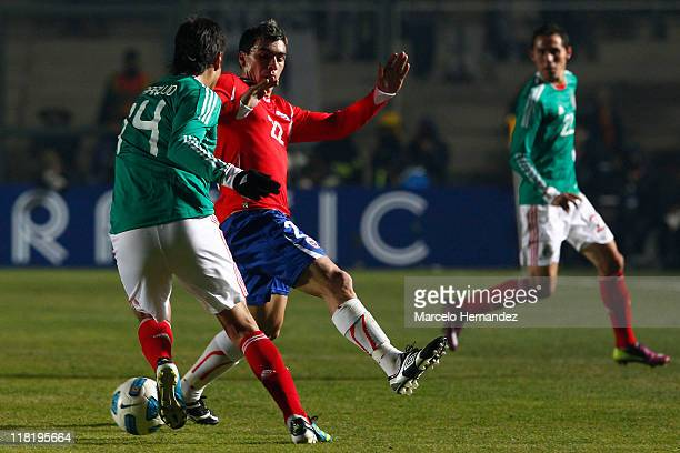 Nestor Araujo of Mexico battles for the ball against Esteban Paredes during a match as part of group C of 2011 Copa America at Bicentenarium Stadium...